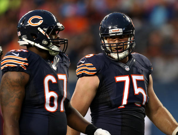 Bears offensive tackle Jordan Mills (67) and offensive guard Kyle Long (75) prepare for a play in front of quarterback Jay Cutler during a preseason game against the San Diego Chargers.