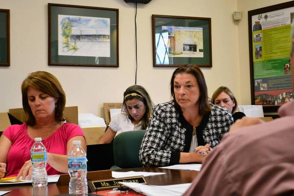 Eileen Maloney (right), Lake Zurich Community Unit School District 95 board member, urged Kathy Brown (left) and other board members to hire a second asbestos inspection firm for May Whitney Elementary.
