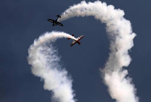 The two pilots of the Firebirds Delta Team fly in close acrobatic formation at the Chicago Air and Water Show.