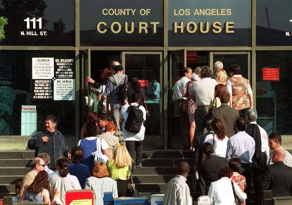 People line up to enter Los Angeles County Superior Court. The state Senate voted Monday to allow noncitizens to serve on juries.