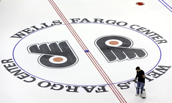 A worker prepares the ice at Wells Fargo Center on Monday for the 2013-14 Philadelphia Flyers season.