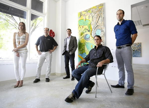 The team behind the Urban Art Museum: Jai Gallery director Coralie Claeysen-Gleyzon (from left), gallery owner Dennis Liddy, co-founder Wes Featherston, artist Marcos Cruz and co-founder and James Cornetet. They are standing by one of Cruz's works in the Jai Gallery in downtown Orlando. The first piece for the outdoor Urban Art Museum will be by Cruz and will be created with the same technique as this piece -- but will be much bigger located at 934 N. Mills Avenue.