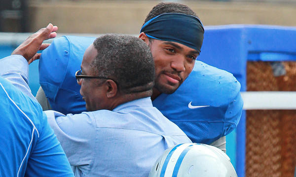 Middle Tennessee State defensive end Steven Rhodes hugs university president Dr. Sidney McPhee during a team practice session Monday.