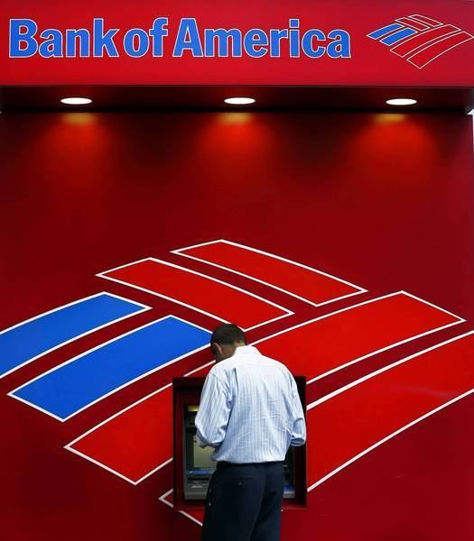 "Despite making the required monthly business debit card transaction in June, Bob Bobbe was charged a $16 fee by Bank of America because it didn't ""post"" to his checking account until July 1. Above, a customer uses an ATM at a branch last month in Charlotte, N.C."