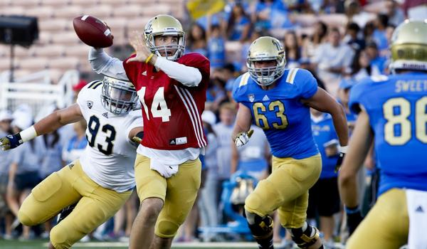 UCLA quarterback T.J. Millweard (14), shown at spring game in April, was battling for the Bruins' backup quarterback spot.