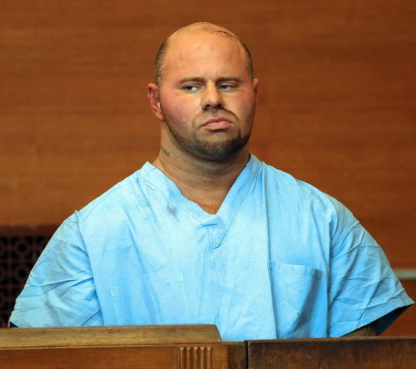 Jared Remy in Waltham District Court in Massachusetts on Friday at his arraignment for allegedly murdering Jennifer Martel, his girlfriend. His earlier arrest for assaulting Martel raised questions about his release from custody.