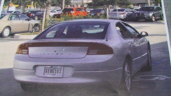 Newly released surveillance video shows a man stealing two expensive radio controlled trucks from Maniacs Hobby Complex in Plantation and escaping in this silver Dodge Intrepid