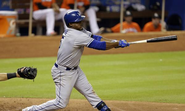 Dodgers third baseman Juan Uribe follows through on a single during the fifth inning of Monday's 6-2 loss to the Miami Marlins.