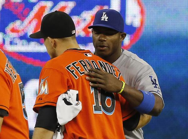 Miami Marlins starting pitcher Jose Fernandez of Cuba is greeted by Los Angeles Dodgers right fielder Yasiel Puig (R) before the start of play in their MLB baseball game in Miami, Florida August 19, 2013. REUTERS/Joe Skipper (UNITED STATES - Tags: SPORT BASEBALL) ORG XMIT: JLS12
