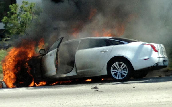 Dick Van Dyke's car burns on the side of the 101 freeway between Calabasas and West Hills on Monday afternoon. Photo by Dan Santos / Los Angeles Times.