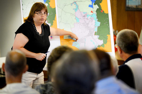 Jill Baker, a planner with Washington County, answers questions about Boonsboro town growth from people gathered Monday night at the Boonsboro Community Center.