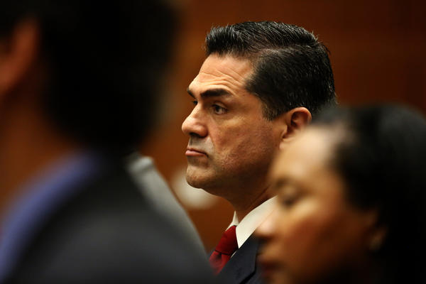 John Noguez, who was elected L.A. County assessor in 2010, still officially holds the top position but has been on paid leave for more than a year after the district attorney's office opened an investigation that led to charges against him.