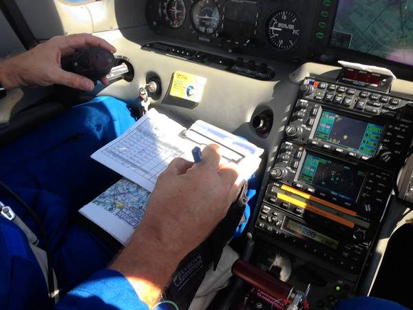 """Rick Yasky, NASA-Langley Research Center chief pilot, keeps records of different test runs that pit his aircraft against a Cessna """"intruder."""" The test is designed to evaluate software that will allow unmanned aircraft to sense and avoid other aircraft while flying in civilian air space."""
