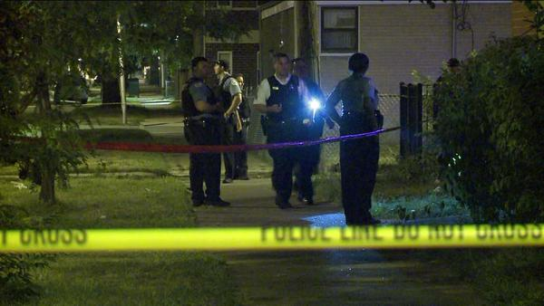 Police search for evidence after a man was fatally shot this morning in the West Englewood neighborhood.