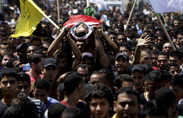 Palestinians carry the body of Majd Lahlouh, 22, during his funeral in the West Bank town of Jenin.