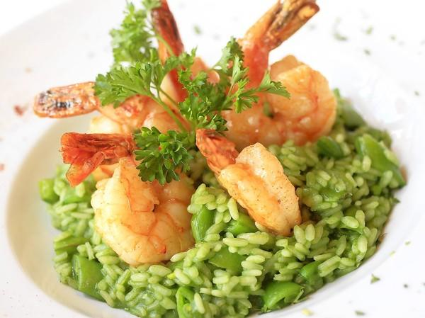 Bayside Restaurant's sauteed tiger prawns over green risotto with sugar snap peas.