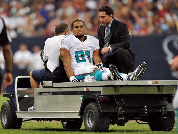 Miami Dolphins tight end Dustin Keller is carted off the field with an injury during the first half against the Houston Texans at Reliant Stadium on Aug. 17.
