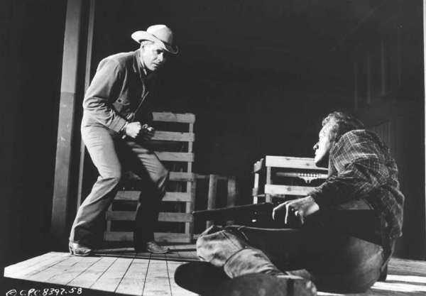 "The 1957 western ""3:10 to Yuma,"" starring Glenn Ford, left, and Van Heflin was based on one of Elmore Leonard's short stories."