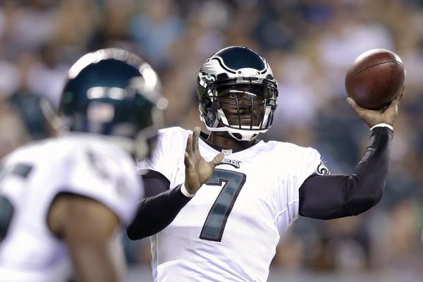 Michael Vick passes during an exhibition game against the Carolina Panthers.