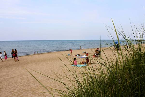 Beachgoers enjoy summer weather on Monday, Aug. 19, 2013, at Gillson Beach in Wilmette.