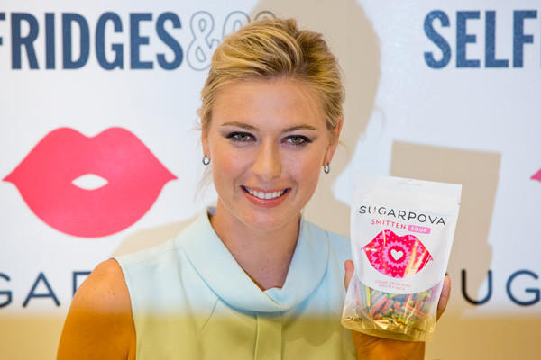 """Tennis player Maria Sharapova poses for photographers as she promotes her """"Sugarpova"""" confectionary brand in London in June."""