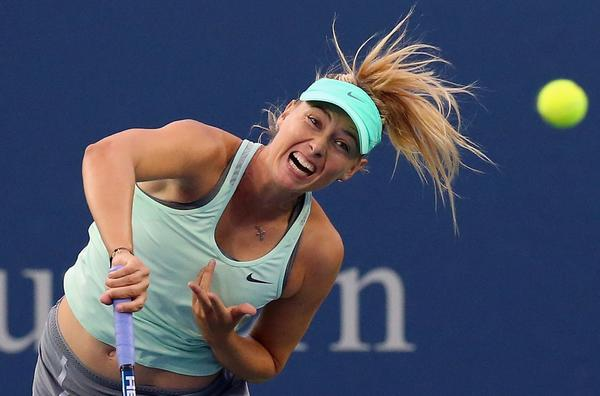 Maria Sharapova, shown playing in the Western & Southern Open last week, has decided against a name change to promote her line of candies and gum.