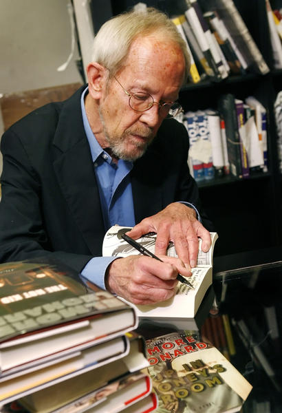 "Author Elmore Leonard signs a copy of his novel ""Up In Honey's Room."""