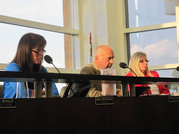From left, Orland Park trustees Carole Ruzich, Ed Schussler and Kathy Fenton discuss newly proposed indoor smoking regulations Monday.