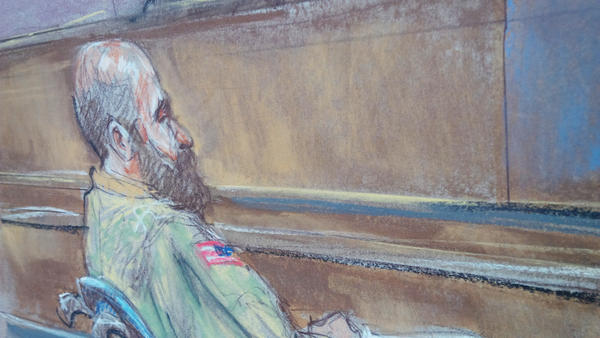 In this courtroom sketch Maj. Nidal Malik Hasan sits at his court-martial in Fort Hood, Texas on Tuesday.