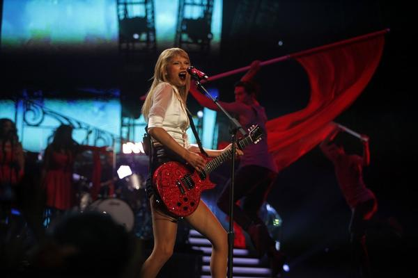Taylor Swift plays the guitar during the first of four sold-out shows at Staples Center on Monday night.