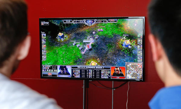 A monitor shows a live webcast of a match being played in the League Championship Series for League of Legends, a tournament for a PC-based video game, at Riot Studios in Santa Monica.