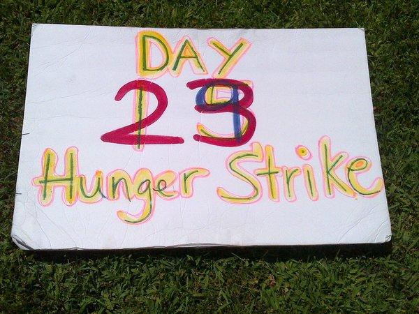 A protest placard on the lawn of the Capitol, where advocates of California inmates on hunger strike rallied to draw attention to the protest, now in its 44th day.