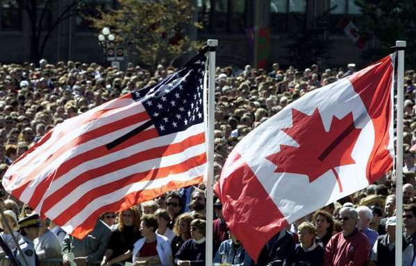 U.S. and Canadian flags: GOP Sen. Ted Cruz of Texas will pledge allegiance to only one.