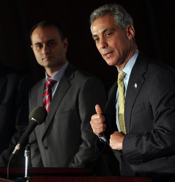 Mayor Rahm Emanuel, seen here with Amer Ahmad announcing his hiring in 2011, defended the choice for city comptroller Tuesday. Ahmad was indicted in Ohio on corruption charges.