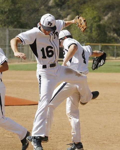 ARCHIVE PHOTO: Flintridge Prep baseball players Brenden McKiernan, left, and Daniel Enzminger celebrate during the a 4-3 win over Crean Lutheran in the CIF Southern Section Division VI quarterfinals. That game was voted the No. 1 game of the year by the Glendale News-Press sports writers.