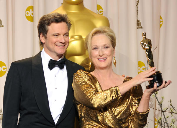 Actor Colin Firth poses with actress Meryl Streep, winner of Best Actress, at the 84th Annual Academy Awards in 2012.