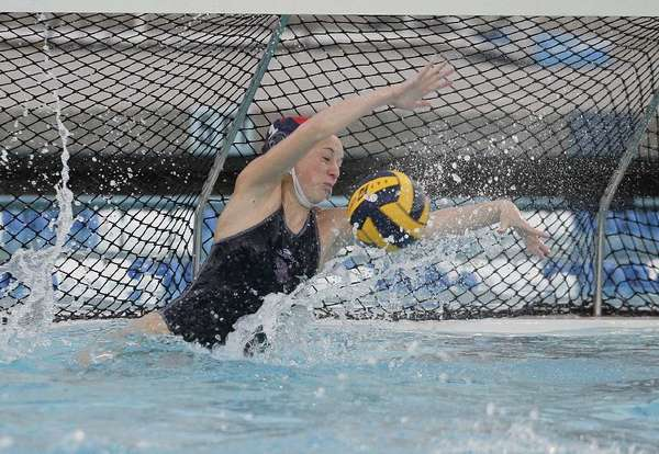 Crescenta Valley High Gabriel Isaccson racked up one of her 16 blocks at during during the CIF-SS Division 5 championships at the Woollett Aquatics Center on Feb. 23 (Scott Smeltzer/File Photo)