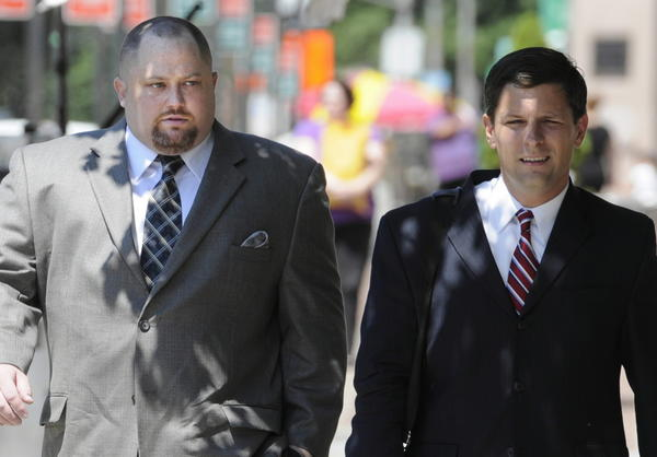 Robert Braddock Jr., left, the former finance director of House Speaker Christopher Donovan's congressional campaign walks to New Haven Federal Court with his attorney Frank J. Ricco Jr. last year before being convicted of conspiring to conceal the source of campaign contributions.
