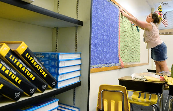 Kristie Callahan, a sixth-grader teacher at Northern Middle School, prepares her classroom for students.