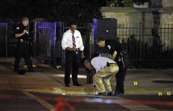 Chicago forensic investigators work the scene of Monday's shooting.