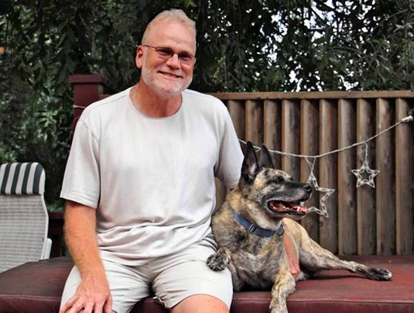 Gilbert White, 54, of Wescosville, with his 8 year old Akita/Staffordshire Terrier mix, Yoda