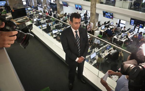 Ehab Al Shihabi, interim CEO for Al-Jazeera America, listens during an interview overlooking the newsroom, after the network's first broadcast on Tuesday, Aug. 20, 2013 in New York.