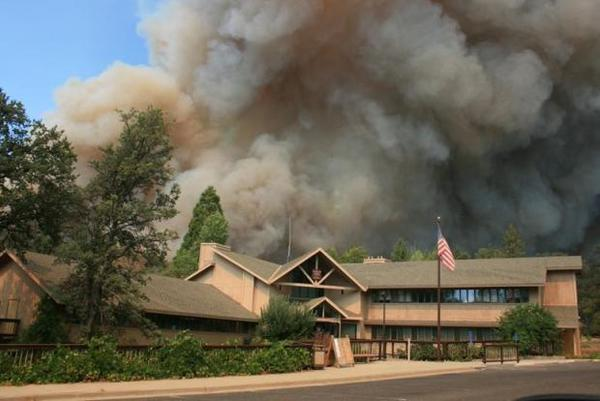 Thick smoke rises from the Rim fire near the Groveland ranger station.