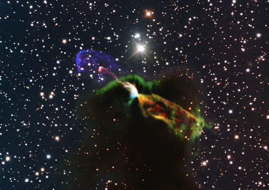 A composite image of Herbig-Haro 46/47 shows jets of gas moving away from a star in the process of being born.