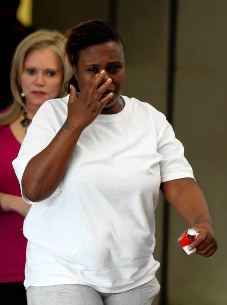Erika Jackson, front, the mother of a 15-year-old boy accused of shooting a child, leaves the Leighton Criminal Court Building on Tuesday in Chicago.