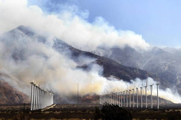 Smoke from the Silver fire near the 10 Freeway blows east over the windmills toward Palm Springs on Aug. 8. The fire burned more than 20,000 acres and destroyed 26 homes.