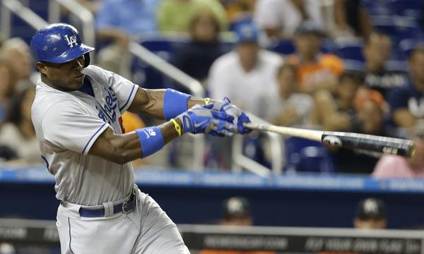 Dodgers outfielder Yasiel Puig hits a solo home run in the eighth inning to help lift the Dodgers to a 6-4 victory over the Miami Marlins on Tuesday.