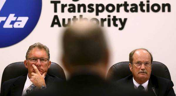 "RTA Chairman John Gates Jr., left, with board member Dwight Magalis: ""All costs ... should have been claimed under Metra's ... insurance policy, instead of paid from taxpayer funds."""