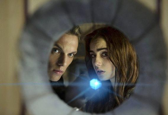 "Jamie Campbell Bower and Lily Collins star in ""The Mortal Instruments: City of Bones."""