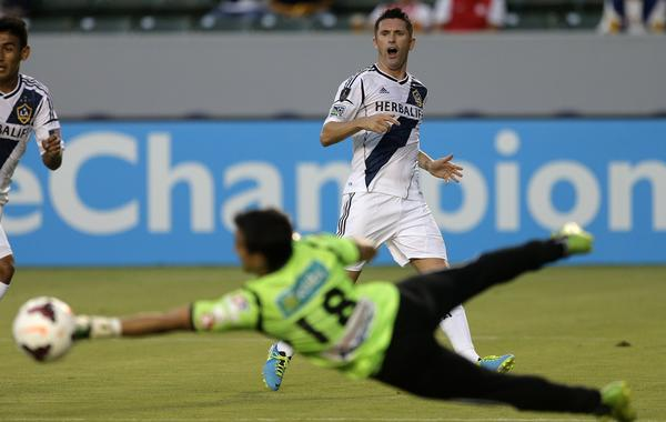 Galaxy forward Robbie Keane, top, reacts after Cartagines goalie Wardy Alfaro blocks his shot during the first half of the Galaxy's 2-0 win Tuesday.
